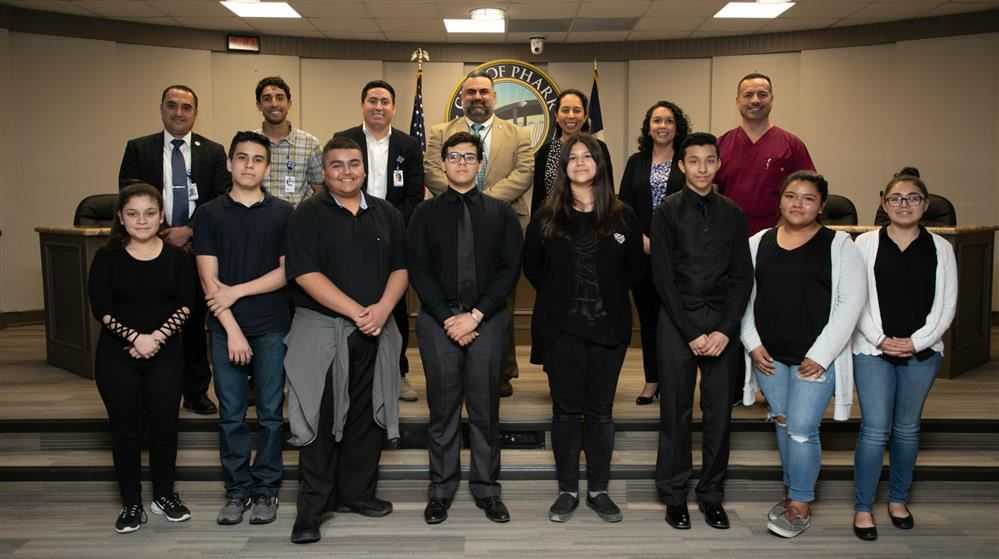 A group of PSJA Southwest Early College High School students pictured with City of Pharr leaders.