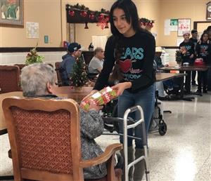 RYMS student gifts nursing home resident with handknit scarf
